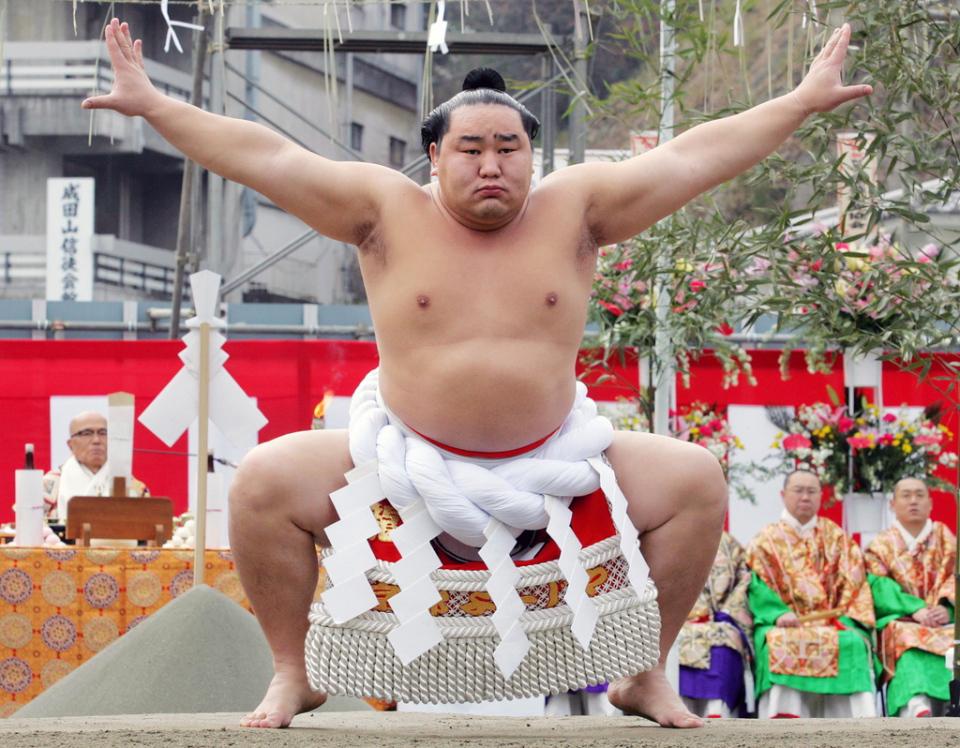 Sumo grand champion Asashoryu of Mongolia performs sacred ring-entering ritual at Naritasan Shinshoji temple in Narita, east of Tokyo